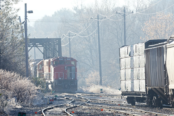 On a cold, frosty morning, NECR train 608 works its way across the iron bridge at the south end of their Palmer MA yard.<br /> 11/15/2017 - 598C4451dK