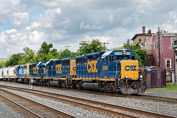 Sporting four GP40s instead of the usual pair, train B740 backs off the controlled siding at MP83 onto the yard lead with a cut of cars for the Mass Central. 6/20/2017 - 598C2442dK