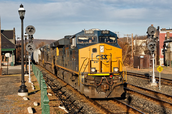 Running straight into the low morning sun, train Q426 eases into the CSX yard at MP83 in Palmer MA.<br /> 11/25/2017 - 598C4522dK