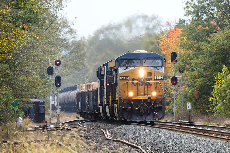Framed by some early Fall color, CSX train Q426 splits the signals at MP64 in East Brookfield MA.<br /> 10/11/2017 - 598C4019dK