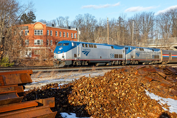 Heading directly into the the low afternoon sun, Amtrak train 449 rolls through MP64 in East Brookfield MA.<br /> 12/20/2017 - 598C5054dK