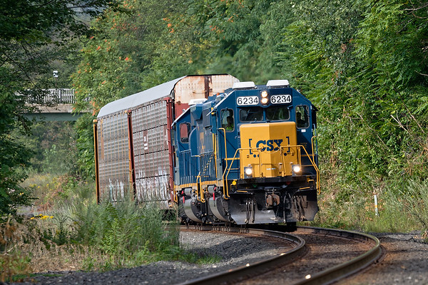 In an infrequent move, Train B740, which usually runs between Springfield and Palmer, hauls a pair of auto racks through West Warren on it's way to the EB&S in East Brookfield MA.<br /> 8/17/2017 - 598C3098dK
