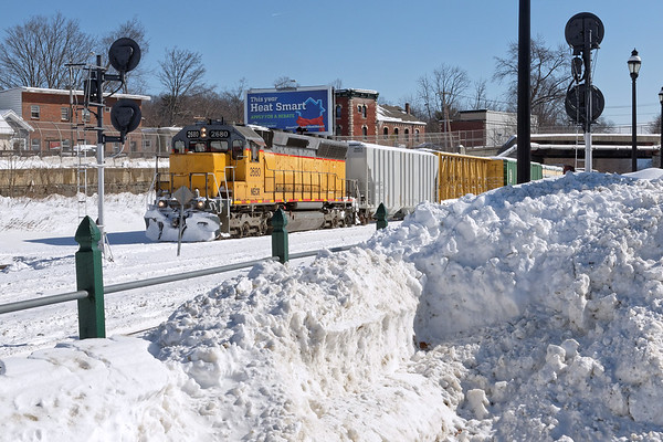 Framed by snow piles from our first serious taste of Winter, NECR 2680 backs a cut of cars down the CSX yard lead at MP83 in Palmer, MA.<br /> 2/14/2017 - 598C0429dK
