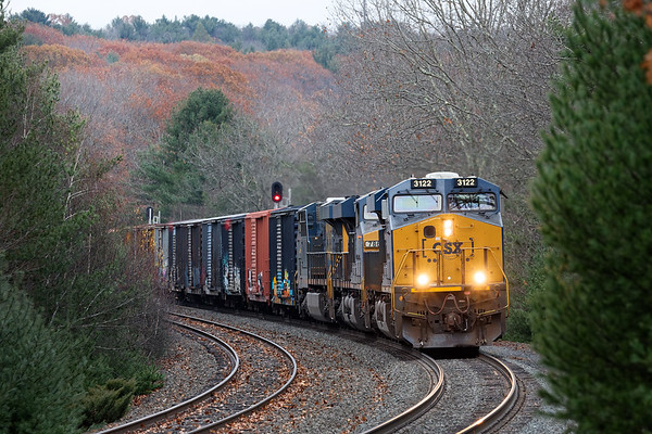 As we all wait for the next seasonal shoe to drop, train Q427 runs through an increasingly bleak looking landscape at MP60 in Spencer, MA.<br /> 11/14/2017 - 598C4436dK