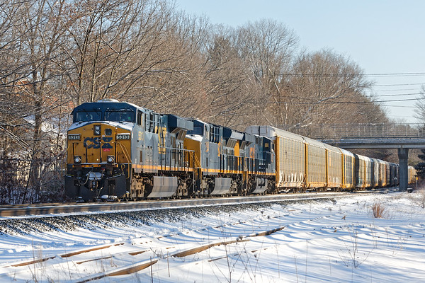Train Q263, which is the flip side of Q264, pulls a string of empty auto racks through MP64 in East Brookfield MA. 12/31/2017 - 598C5074dK
