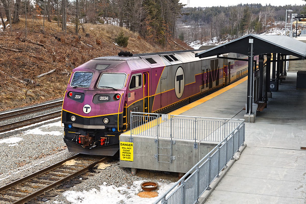 """A """"T"""" commuter train sits quietly at the new Wachusett station in West Fitchburg MA. Evidently the """"T"""" hasn't been able to solve the issue of exhaust schmeg coating the front of the new engines on the inbound runs. 1/29/2017 - 6V4A0161dK"""