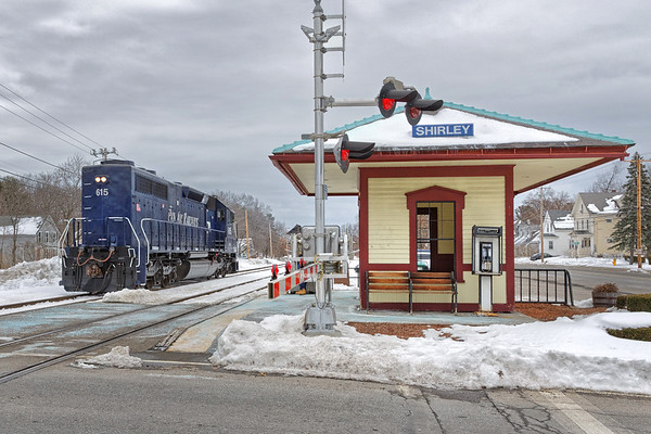 Running long hood forward, switcher AY-4 heads through Shirley to Fitchburg for a pickup.<br /> 3/19/2017 - 598C0787dK