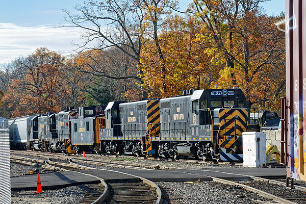 Against a backdrop of late Fall color, Grafton & Upton RR's power lineup sits quietly in their yard in Grafton, MA.<br /> 11/7/2017 - 598C4305dK