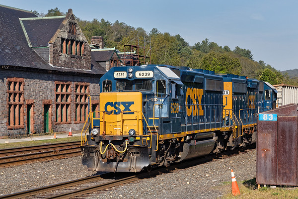 With the historic Palmer Depot as a backdrop, train B740 backs down the yard lead with a cut of cars for the Mass Central.<br /> 8/28/2017 - 598C3265dK