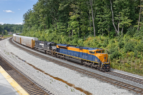 With NS 1071, the Jersey Central Lines Heritage Unit leading NS 2516, train 28N eases down the hill past the new MBTA Wachusett Station in West Fitchburg MA. 8/30/2017 - 6V4A6618dK