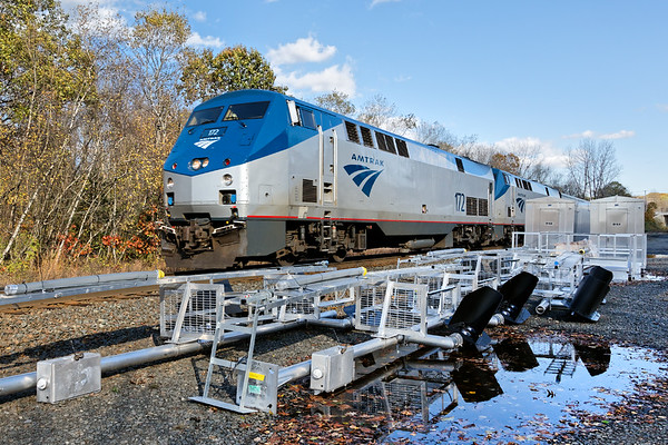 Signal replacement in Charlton MA.<br /> Amtrak 449 rolls past new signals, masts, catwalks and control sheds all staged at MP57.<br /> 10/31/2017 - 598C4247dK