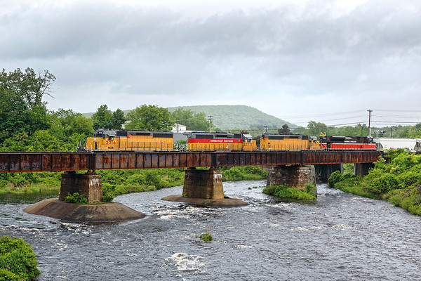 NECR train 611 heads north across the bridge at Three Rivers, MA with 4 units on the point, including P&W 4302 which is headed for St. Albans to be painted in G&W orange livery.<br /> 5/26/2017 - 598C2207d