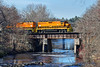 With NECR (B&P) 3000, the Mortimer B. Fuller III named unit on the point, NECR train 603 crosses the Quabaog River just north of Palmer, MA.<br /> 4/23/2017 - 598C1509dK