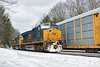 Running at track speed, train Q022 flies past 264's auto racks at MP60 in Spencer, MA. 2/16/2017 - 598C0508dK