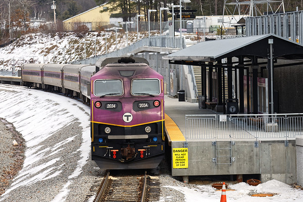 "A ""T"" commuter train sits quietly at the new Wachusett station in West Fitchburg MA. Evidently the ""T"" hasn't been able to solve the issue of exhaust schmeg coating the front of the new engines on the inbound runs. 1/29/2017 - 6V4A0158dK"