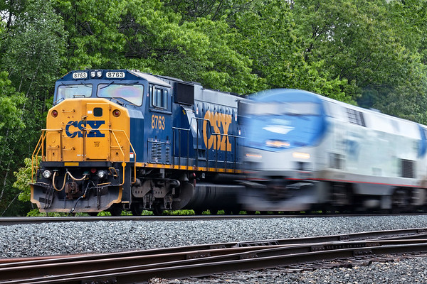 Train Q264 light power sits tied down on the controlled siding at MP64 in East Brookfield, MA as Amtrak 449 blasts past at track speed on the main.<br /> 5/30/2017 - 598C2263dK
