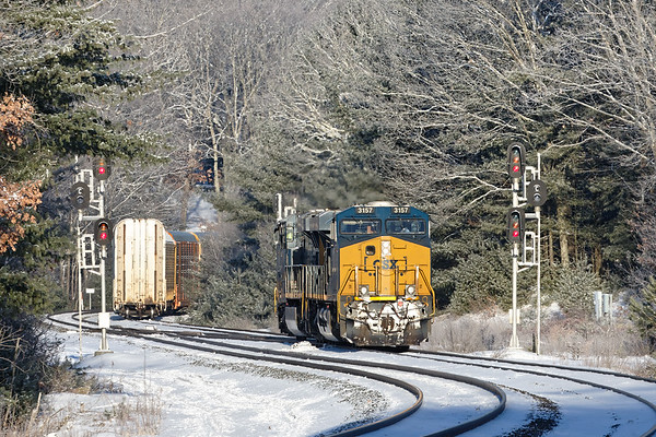 """With yesterday's light """"powdered sugar"""" snowfall still on the trees, CSX train Q264 drops a long drag of auto racks on the siding at MP60 in Spencer MA.<br /> 12/31/2017 - 598C5071dK"""
