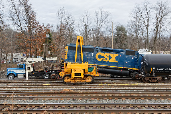 """""""...Glad we've got triple A...""""<br /> CSX GP40-2, no. 6207 broke an axle yesterday as it crossed the diamond at MP83 in Palmer MA. She was dragged onto one of the siding tracks in the CSX yard in Palmer for repairs and she's been hanging in the air for a while as the repair crew waits for parts to come from Selkirk.<br /> 12/8/2017 - 598C4827dK"""