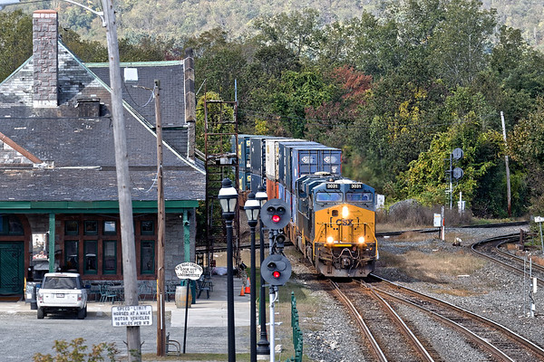 Train Q022-03 heads east across the diamond and past the historic depot at MP83 in Palmer, MA. 10/3/2017 - 598C3940dK