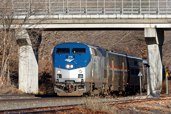Back on the B&A, Amtrak 449 ducks under the bridge into the late afternoon light at MP64 in East Brookfield, MA. 1/13/2017 - 598C0298dK