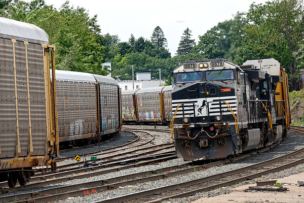 Who's buying all the cars?<br /> Seems like auto racks were everywhere in the Gardner yard as train 28N pulls up for a recrew after dropping a cut of cars for the P&W.<br /> 6/22/2017 - 598C2542dK