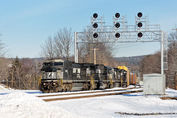 Pulling a relatively short drag of empty auto racks, train 287 climbs the hill near the new Wachusett 'T' station in West Fitchburg. 2/21/2017 - 598C0528dK