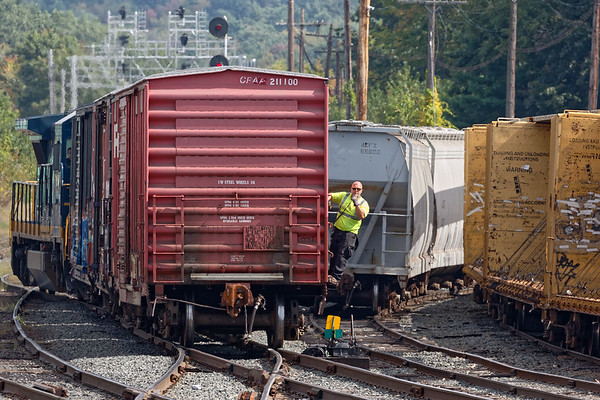 The human element in railroading is the most important and the most vulnerable.<br /> Surrounded by railcars on all sides, FI-1 switches the Gardner MA yard under the watchful eye of the conductor.<br /> 9/26/2017 - 598C3880dK