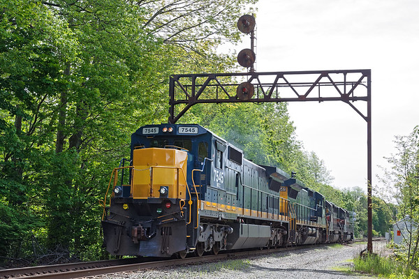 Train POED light power backs under the ancient signal bridge at Parker's at the west end of the Gardner yard.<br /> 6/8/2017 - 598C2345dK