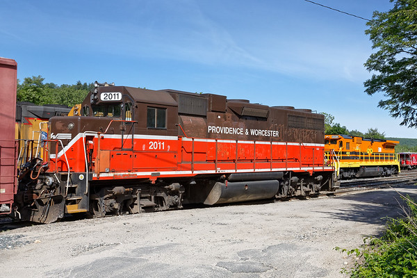 """Something old, something new...<br /> In it's """"old"""" brown and red livery, P&W 2011 is tied down in Palmer, MA right next to P&W 4002 which is sporting the """"new"""" G&W (P&W) paint job.<br /> 6/4/2017 - 598C2301dK"""