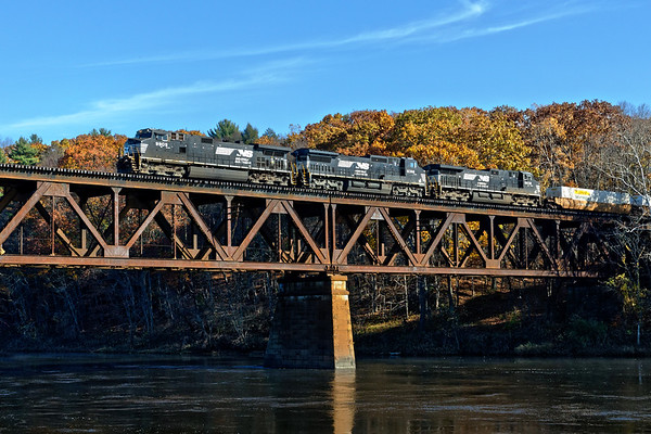 With fading late season foliage as a background, train 23K crosses the Connecticut River on the iron bridge at the east end of the East Deerfield yard. 11/9/2017 - 598C4321dK