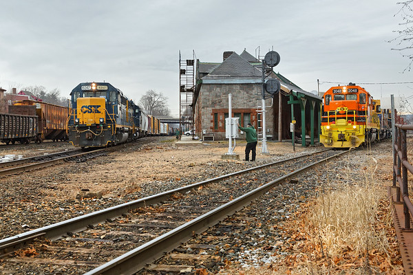Meet you at the diamond!<br /> In Palmer MA, NECR 2048 waits to cross the diamond as CSX train B740 eases onto the main to head west to Springfield.<br /> 1/17/2017 - 598C0394dK