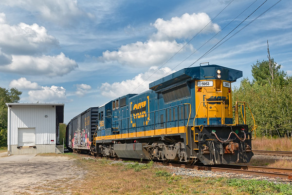 Under beautiful late summer skies, switcher FI-1 pulls a string of empties at Otter River MA. 9/26/2017 - 598C3866dK