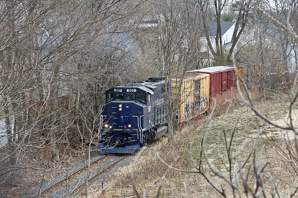 Seen from the Logan St bridge, the Heywood Branch winds it's way through the undergrowth behind the houses on Chestnut St. 4/19/2017 - 598C1385dK