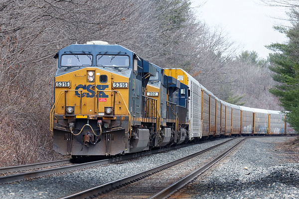 Utilizing Q264's power, the East Brookfield and Spencer Railroad switches out a cut of empty auto racks just east of MP64 in East Brookfield MA.<br /> 4/13/2018