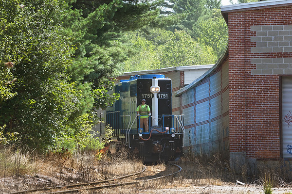 MCER 1751 starts backing down the hill to pull a cut of cars from the mill complex in South Barre MA.<br /> 8/10/2018