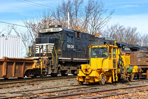 The trailing engine on 22K, a C40-9 standard cab top hat unit, comes into better view as the train backs down past a funky little piece of track equipment on the east wye of the Hill yard in Ayer MA. 2/13/2018