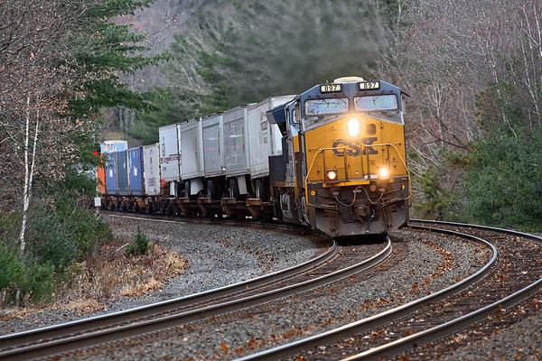 Running through a bleak late Fall landscape, Q012 hits the S-curves at MP60 in Spencer MA.<br /> 11/15/2018