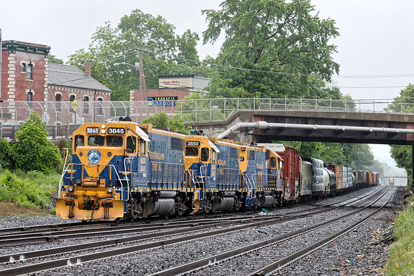 A few hours in the rain in Palmer MA...<br /> NECR 608 on the CSX yard lead with B740 holding the controlled siding in the distance.<br /> 6/4/2018