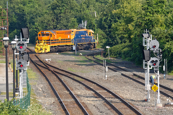 NECR 3850 and 3476 cross the diamond at MP83 in Palmer MA.<br /> 7/17/2018