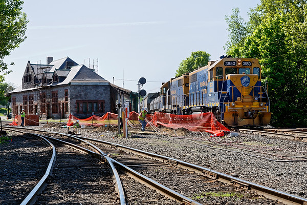 NECR 3850 eases across the diamond at MP83 as CSX crews continue work installing the new cabanas and signals.<br /> 5/24/2018