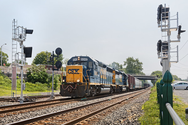 Departing from Palmer MA, train B740 is framed by the old and new signals at MP83.<br /> 7/5/2018
