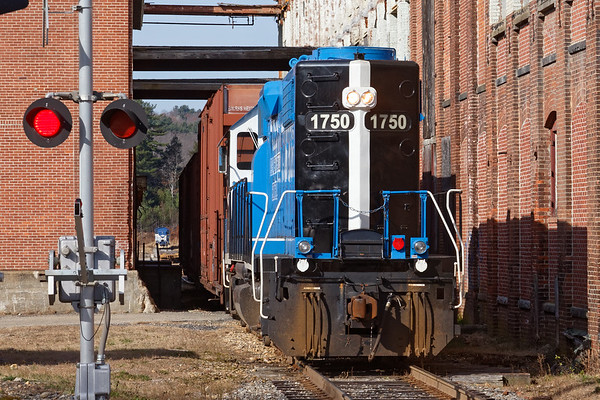 MCER 1750 backing into the South Barre mill complex. In the distance, almost hidden from view, are two units previously stored in Ware - MCER 960, an EMD GP20 and MCER 2100, an EMD NW5.<br /> 11/12/2018