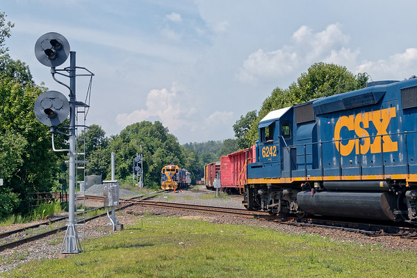 In Palmer, Train B740 heads west as the NECR Geometry Train waits to cross the diamond.<br /> 8/7/2018