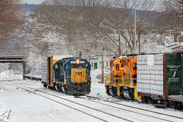 With snow from our latest Nor'easter still hanging on the trees, B740 holds the siding as NECR pulls a cut of cars from the CSX yard at Palmer MA.<br /> 3/14/2018