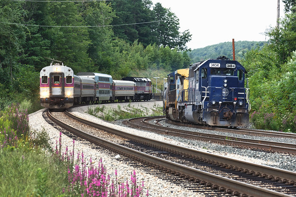 At Wachusett, an inbound commuter comes off the station track past EDPO which is tied down waiting for a crew.<br /> 8/20/2018