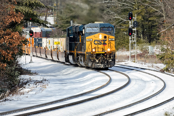Train Q022 rolls through the S-curves at MP60 in Spencer MA with a long drag of containers for Worcester.<br /> 2/8/2018