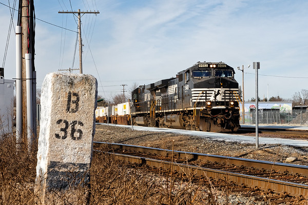 """Train 22K eases past the """"Boston 36"""" mile marker in the center of Ayer MA.<br /> 2/13/2018"""