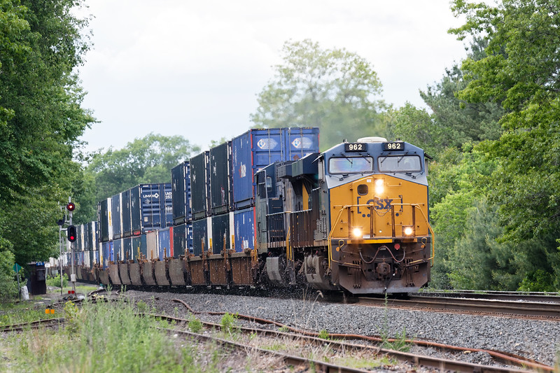 CSX train Q020 blasts through MP64 in East Brookfield MA with a long drag of stacks for Worcester.<br /> 6/6/2018