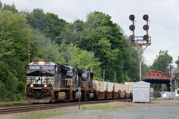 With three NS units running elephant style, train 22K backs down under the Main St bridge and onto the east wye in Ayer MA.<br /> 8/20/2018