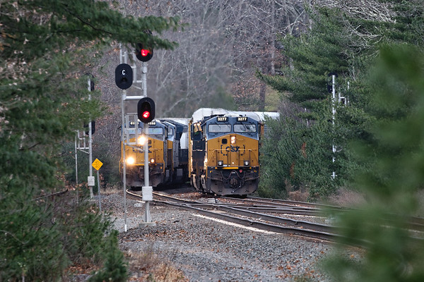 The landscape has changed to Winter mode as we've lost what little Fall color we had this year. At MP60 in Spencer MA, Q264 holds the siding as Q012 roars by at track speed on the main.<br /> 11/15/2018